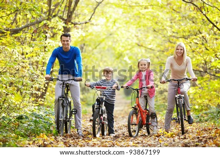 Families with children on bicycles - stock photo