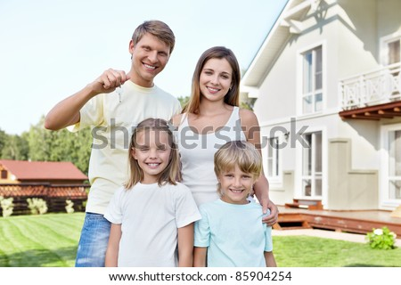 Families with children with the keys in the background at home - stock photo