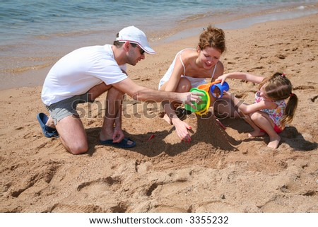 familly on beach 2 - stock photo