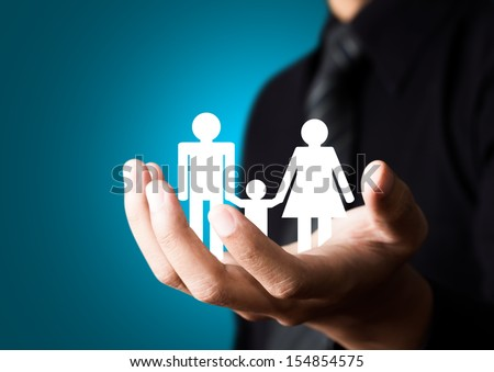 Family abstract in male hand, Insurance concept - stock photo