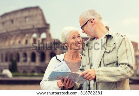 family, age, tourism, travel and people concept - senior couple with map and city guide on street over coliseum background - stock photo