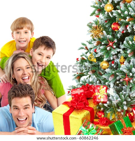 Family and a Christmas Tree. Over white background - stock photo