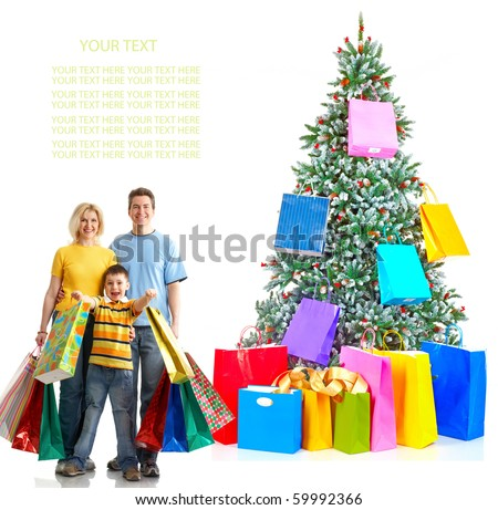 Family and a Christmas Tree. Shopping. Over white background - stock photo