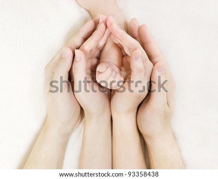 Family and newborn baby hand, mother and father helping new born kid - stock photo
