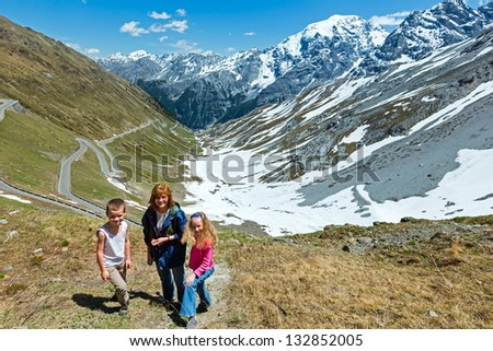 Family and summer Stelvio Pass with snow on mountainside and serpentine road (Italy)   dfgfdghfd