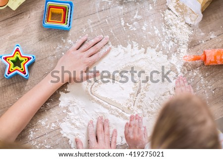 Family are playing with flour and having fun - stock photo
