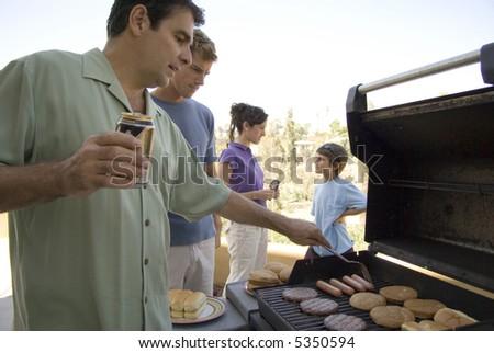 Family at BBQ - stock photo