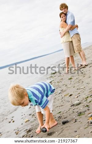 Family at beach - stock photo
