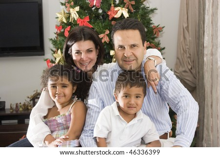 Family at christmas, mom and dad enjoying with their children at christmas