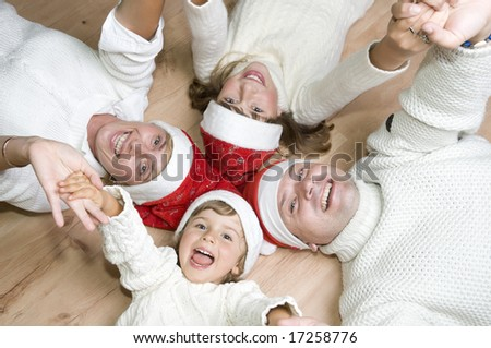 Family at christmas time - stock photo