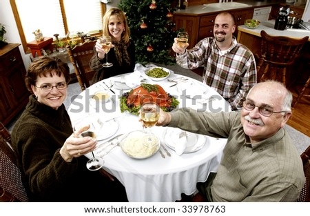 family at holiday dinner - stock photo