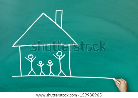 Family at home concept on green blackboard - stock photo