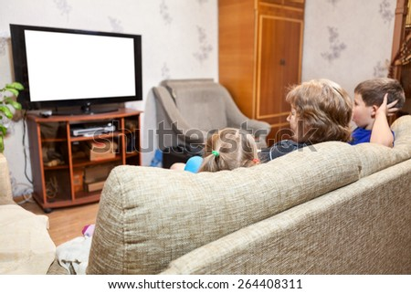 Family at home, watching lcd tv sitting on sofa, three people. Isolated white screen - stock photo