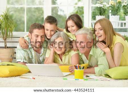 family at home with laptop - stock photo
