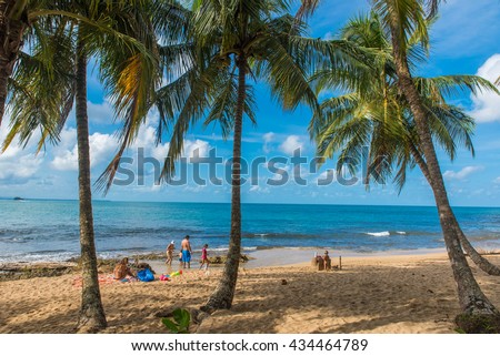 Family at playa Cocles - beautiful tropical beach close to Puerto Viejo - Costa Rica - stock photo