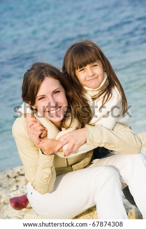 Family at sea, mother and daughter - stock photo