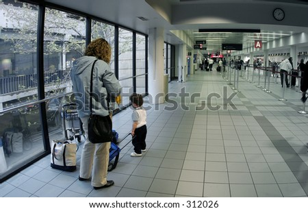 Family at the airport - stock photo