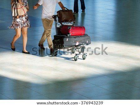 family at the airport is landing to fly on an airplane trip - stock photo