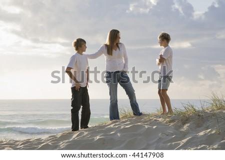 Family at the beach early morning - stock photo