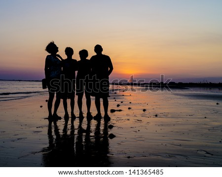 Family at the beach sunset silhouette