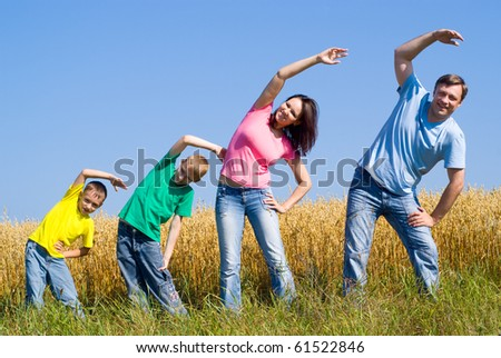 family at the nature in summer park - stock photo