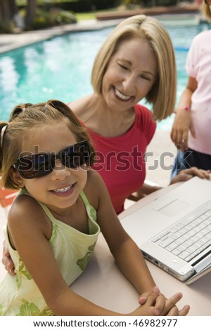 Family at the Pool - stock photo