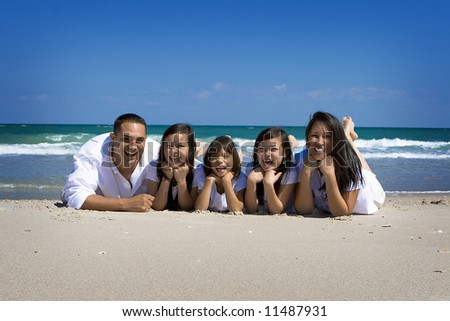 Family at the sea - stock photo