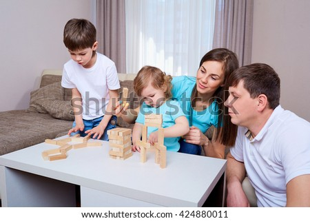 Family at the table playing board games. - stock photo