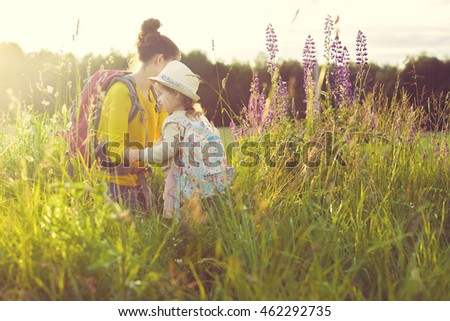 Family backpackers in wood