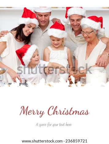 Family baking Christmas cakes and sweets in the kitchen against merry christmas - stock photo