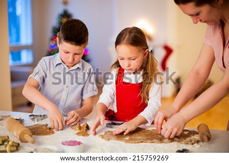 Family baking Christmas cookies at home