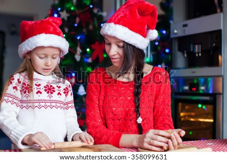 Family baking Christmas cookies at home kitchen on Xmas eve - stock photo