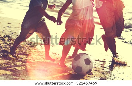 Family Beach Football Holiday Soccer Togetherness Concept - stock photo
