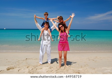 Family beach vacation - stock photo