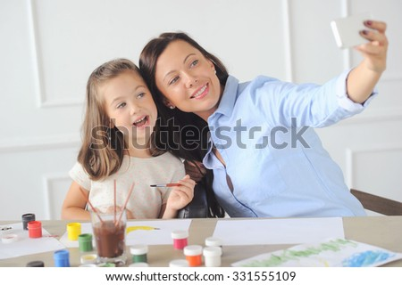 Family. Beautiful mother and her cute daughter - stock photo