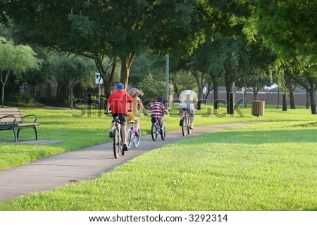 Family biking together in a park in Sugar Land, Texas