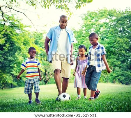 Family Bonding Recreation Sports Football Concept - stock photo
