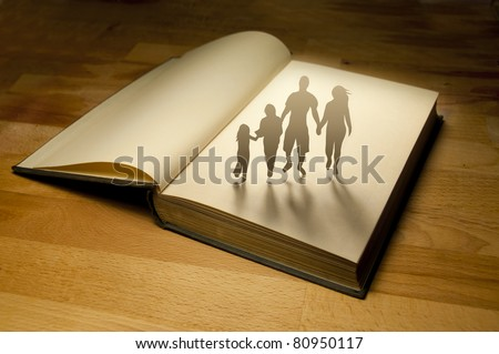 Family Book Story. Conceptual photography. - stock photo