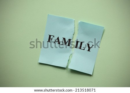 "Family breakdown. Torn of paper with the word ""Family"". Concept Image.  - stock photo"