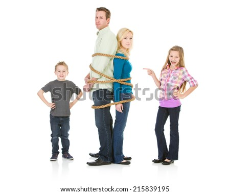 Family: Brother And Sister Tie Up Parents With Rope - stock photo