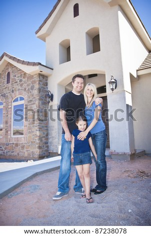 Family building a New Home (under construction) - stock photo