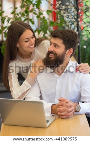 Family business couple in a cafe. On-line shopping.