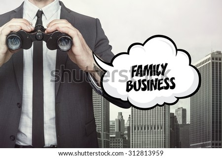 Family business text on speech bubble with businessman holding binoculars on city background - stock photo