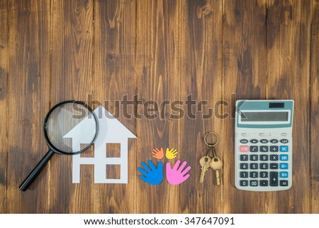 family buy house Mortgage calculations, calculator with Magnifier Searching - stock photo