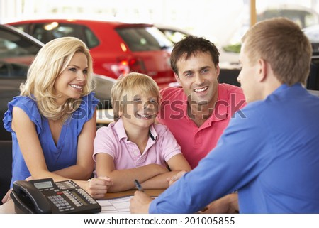 Family buying new car - stock photo