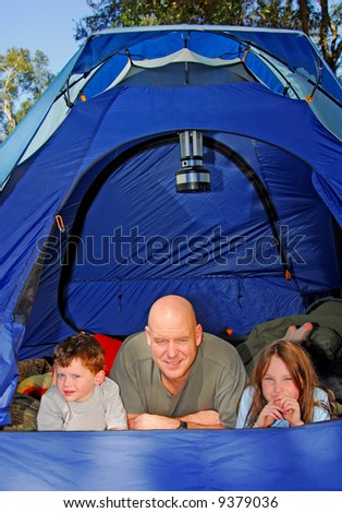 Family camping outdoors - stock photo