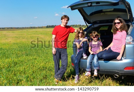 Family car trip on summer vacation, happy parents travel with kids and having fun. Car insurance concept  - stock photo