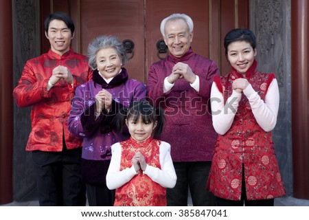 Family Celebrates Chinese New Year - stock photo