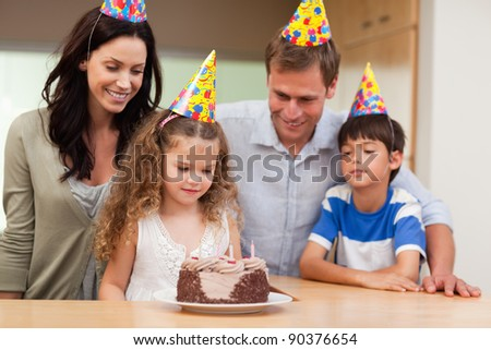 Family celebrating a birthday together - stock photo