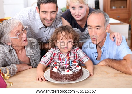 Family celebrating a fourth birthday